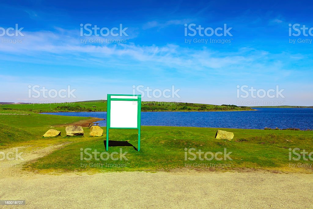 Blank sign by the lake royalty-free stock photo