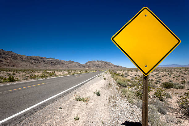 blank sign desert highway - road signs stock photos and pictures