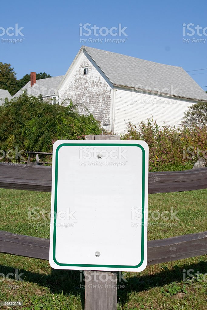 Blank sign on old wood fence stock photo