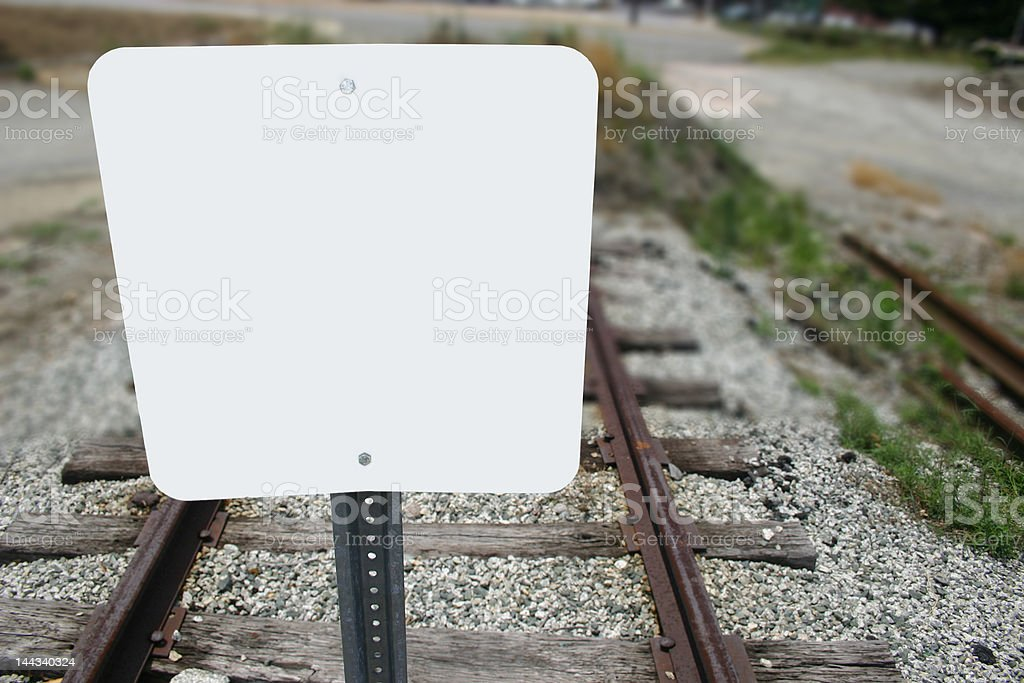 Blank sign on railroad tracks stock photo