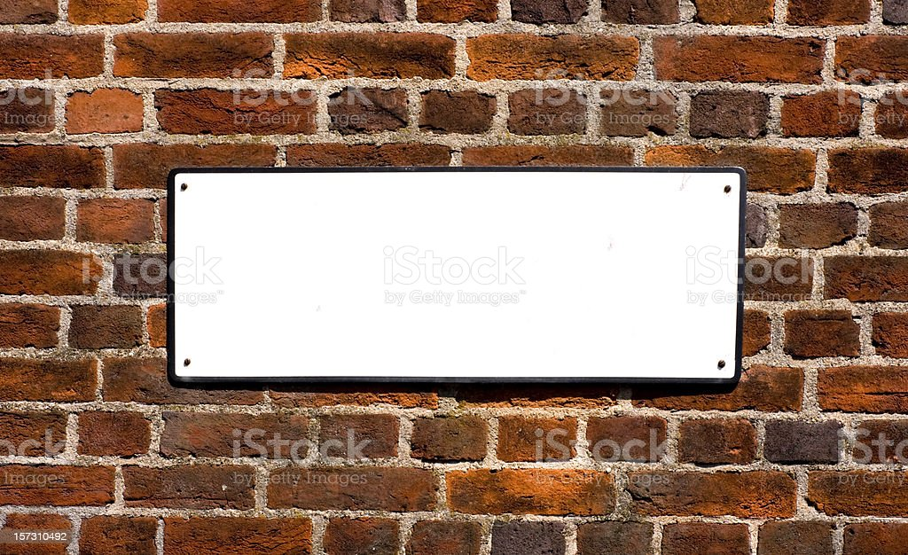 Blank sign on red brick wall royalty-free stock photo