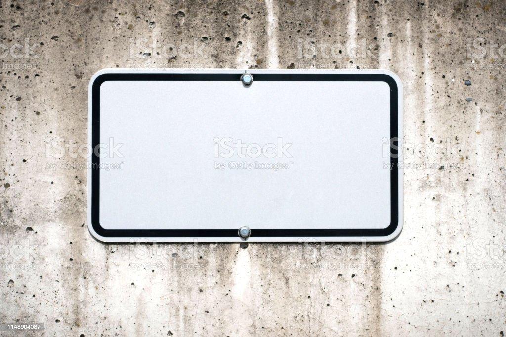 blank sign on wall mock-up - parking spot sign mockup