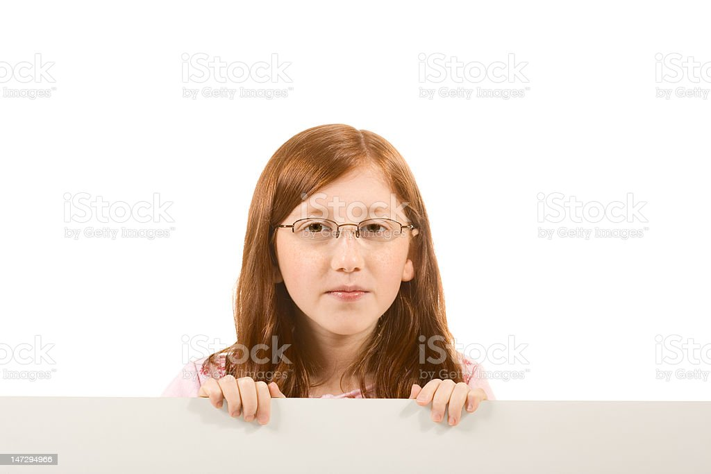 Blank sign red head girl in glasses with copy space royalty-free stock photo