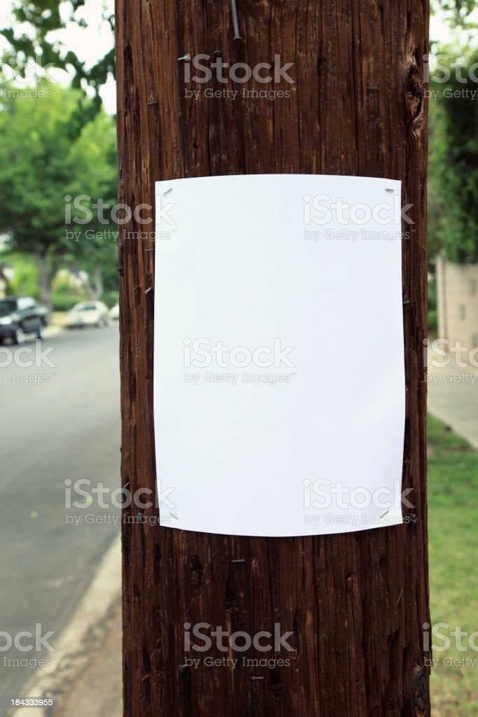 Blank sign stapled to a telephone pole. stock photo