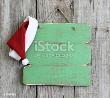 istock Blank sign with Santa Claus hat 493767692