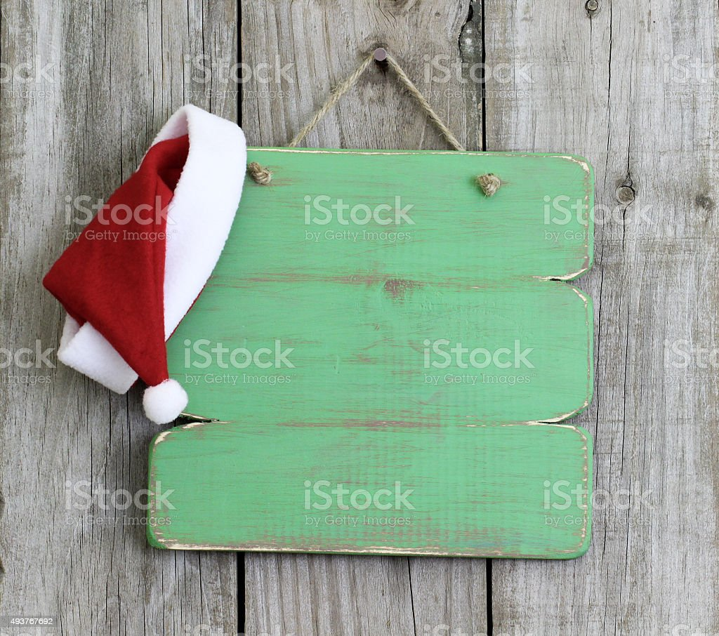 Blank sign with Santa Claus hat stock photo