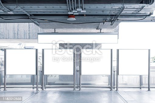 1166703050 istock photo Blank signboard in building train station. It is direction signage mock up for information public transport. Tourists traveling by subway train to get to tourist attractions. 1182012533