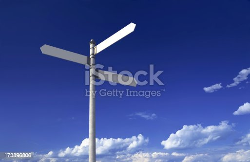 Blank signpost with three arrows over partly cloudy blue sky - just add your text.Precise clipping path included for easy background change.