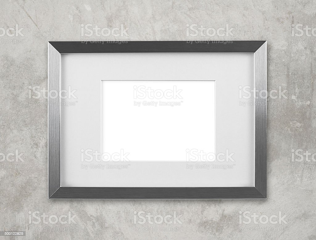 Blank silver picture frame on the wall stock photo