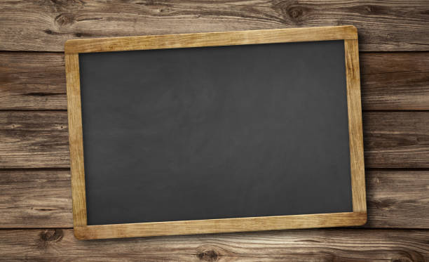 blank slate blackboard and wooden background stock photo