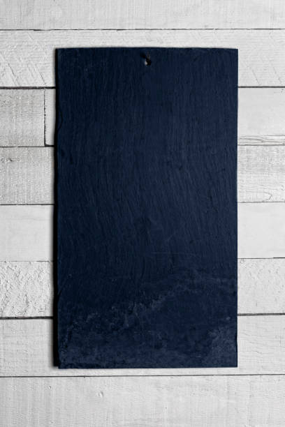 Blank Slate chalk board hanging on shiplap wall. Vertical image with copy space, design element background for text. stock photo