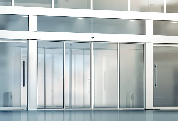 Blank sliding glass doors entrance mockup Blank sliding glass doors entrance mockup, 3d rendering. Commercial automatic entry mock up. Office building exterior template. Closed transparent business centre facade, front view. automatic stock pictures, royalty-free photos & images