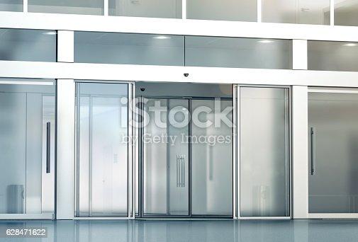 istock Blank sliding glass doors entrance mockup 628471622