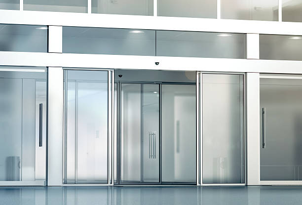 Blank sliding glass doors entrance mockup Blank sliding glass doors entrance mockup, 3d rendering. Commercial automatic slide entry mock up. Office building exterior template. Closed transparent business centre facade, front view. automatic stock pictures, royalty-free photos & images