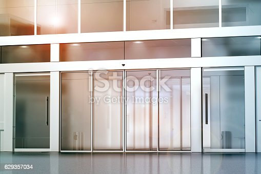 istock Blank sliding glass doors entrance mockup 629357034