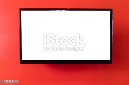 blank smart TV hanging on red concrete wall.
