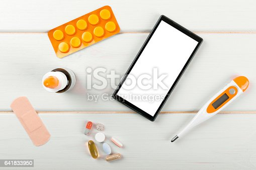 1134879628 istock photo blank smartphone with medical items on the desk 641833950