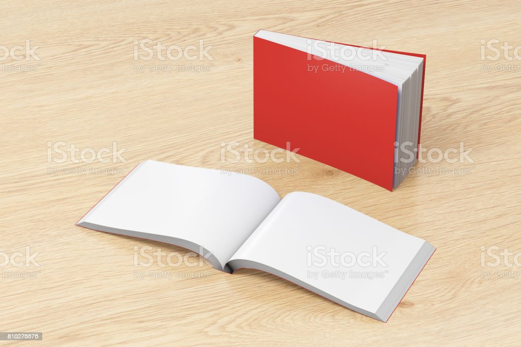 Blank red horizontal soft cover books open and standing on wooden...