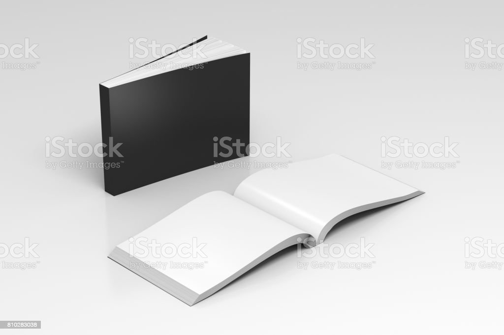 Blank soft cover books opened and standing stock photo
