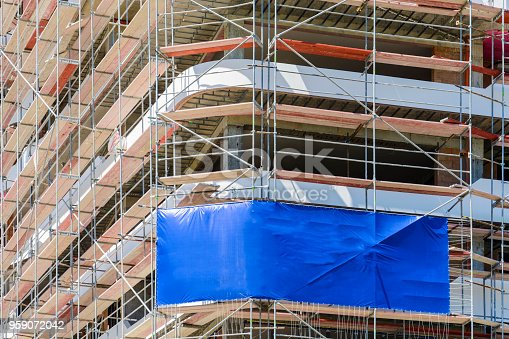 istock Blank space on a scaffolding building for your advertising. blue mockup. 959072042