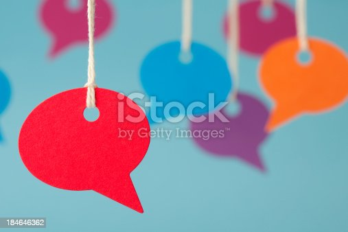Blank speech bubble price labels. Shallow depth of field focus on the red speech bubble in the foreground.