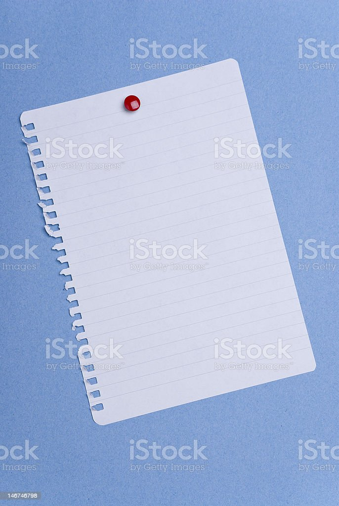 Blank spiral page on blue royalty-free stock photo