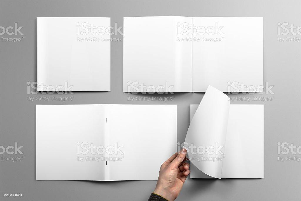 Blank square brochure mockup on light grey background. stock photo