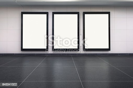 Three blank posters on a station wall. Includes clipping path.