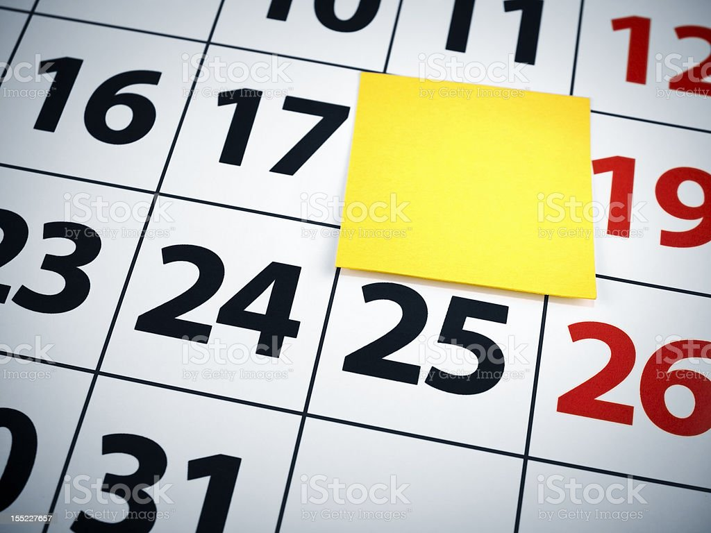 Blank sticky note on a calendar royalty-free stock photo