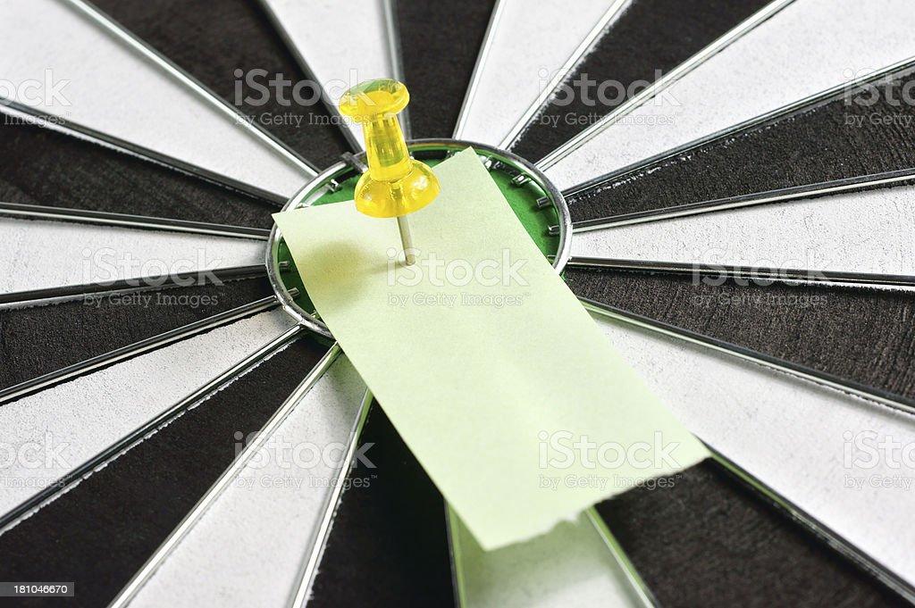 Blank Sticky Note on Dartboard royalty-free stock photo