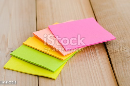 istock blank sticky note or post note colorful green yellow and pink on wood table or wood board. 919107518
