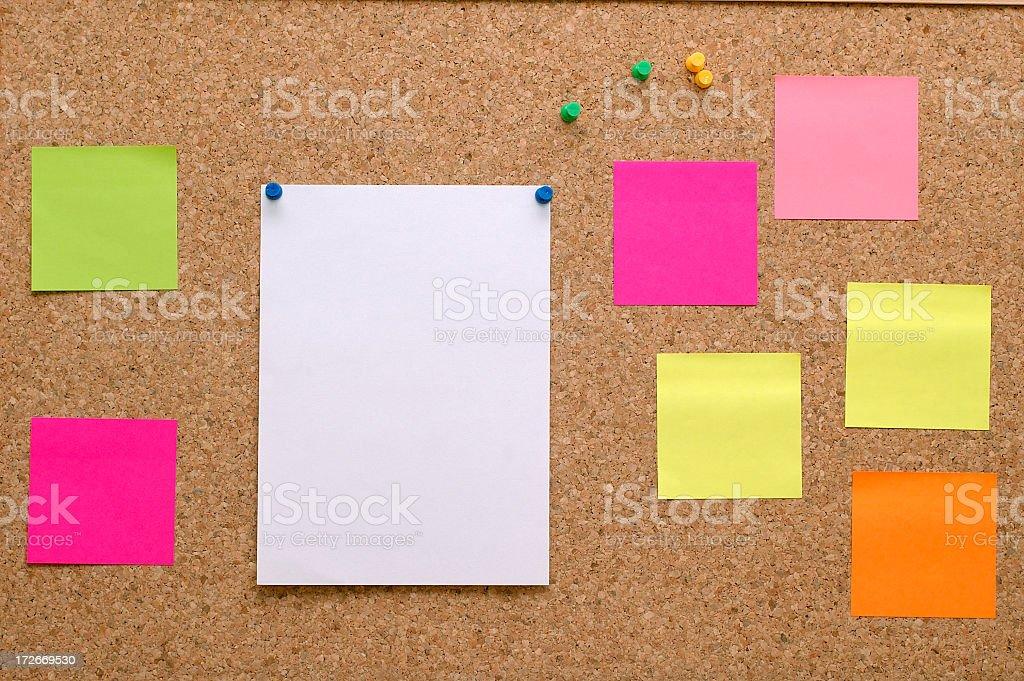 Blank sticky notes stuck on pushpin board royalty-free stock photo
