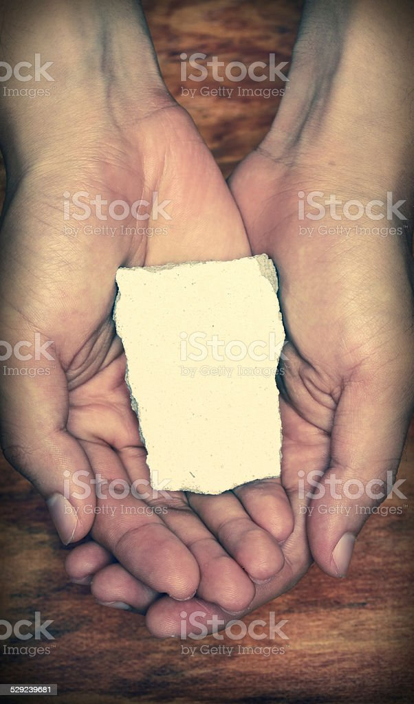 Blank Stone Block In Hands stock photo