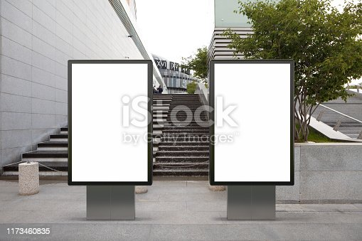 Two blank street billboard poster stands mock up in downtown. 3d illustration.