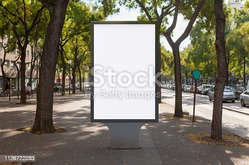 Blank street billboard poster stand on boulevard. 3d illustration.