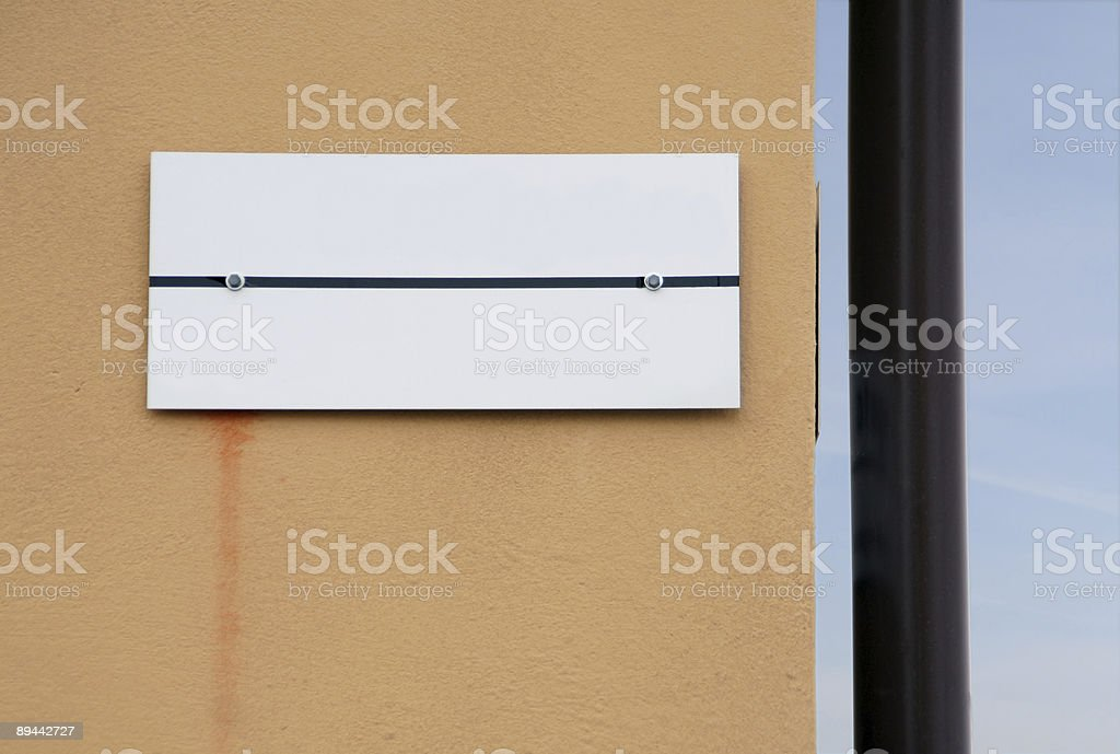Blank street name sign on facade royalty free stockfoto
