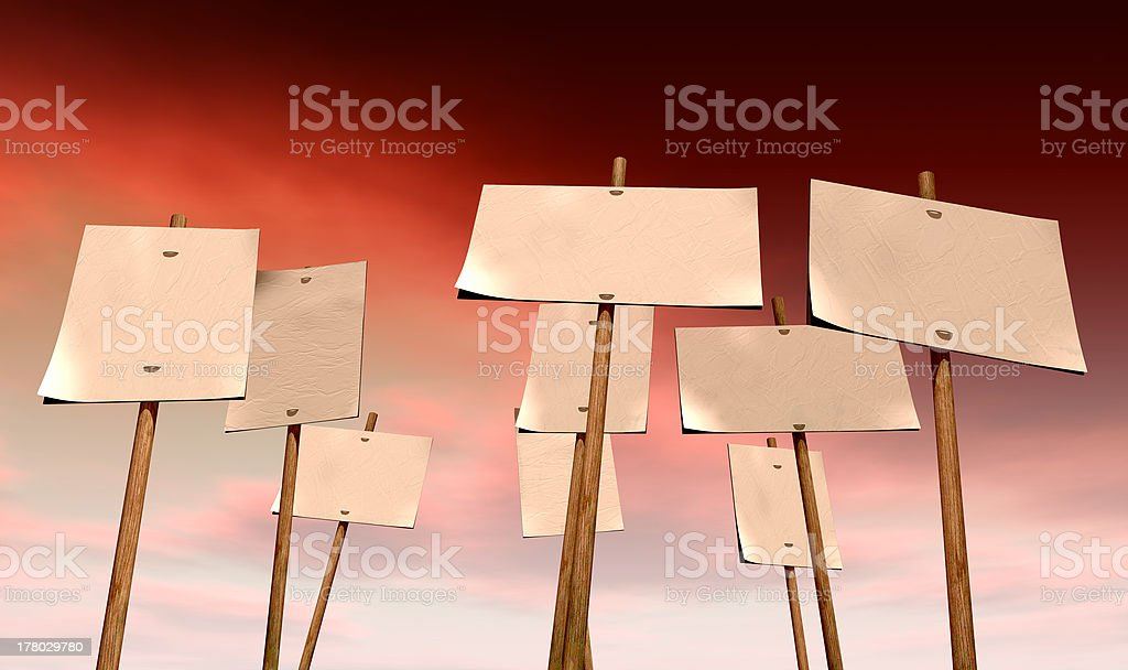 Blank Strikers Picket Plackards And Red Sky stock photo