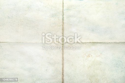 Old sheet of paper blank folded in four, texture background
