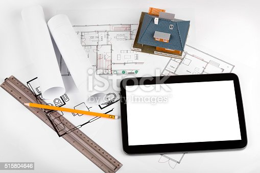 464482634istockphoto blank tablet and house scale model on architectural blueprints 515804646