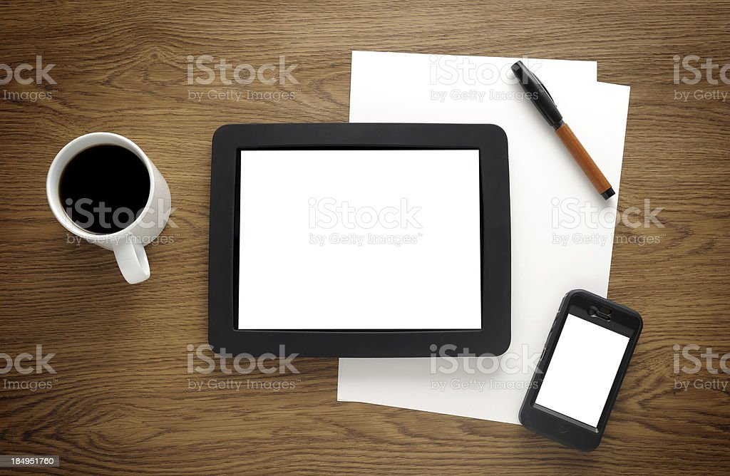 Blank tablet pc and smart phone on desk royalty-free stock photo
