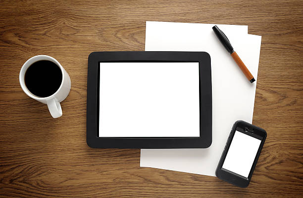 Blank tablet pc and smart phone on desk stock photo