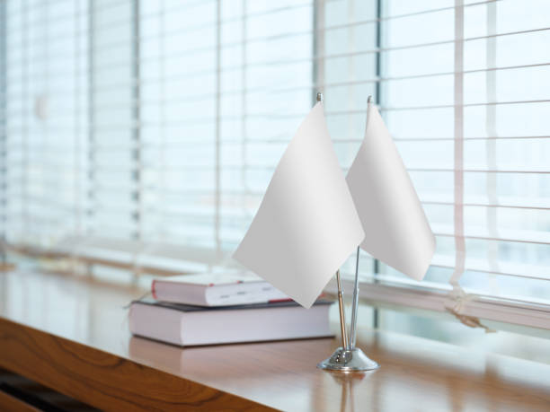 Blank tabletop flags at office (clipping path)