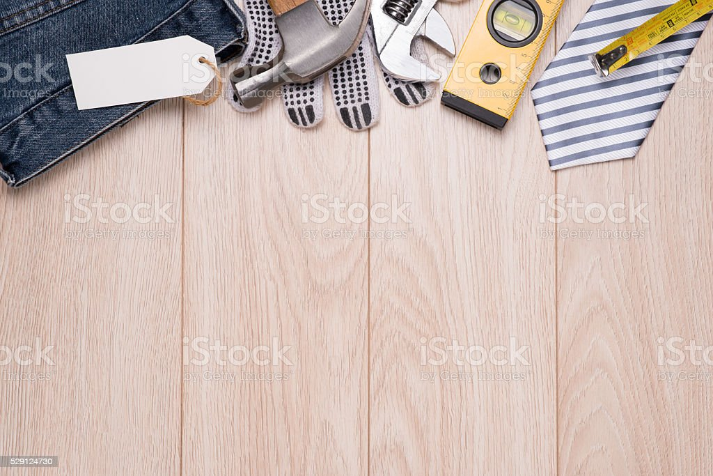 Blank tag with tools and ties border on wood stock photo
