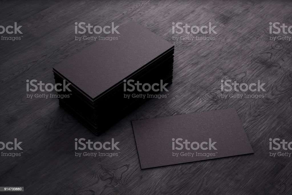 Blank template black Business Cards on black wooden background. 3D rendering. stock photo