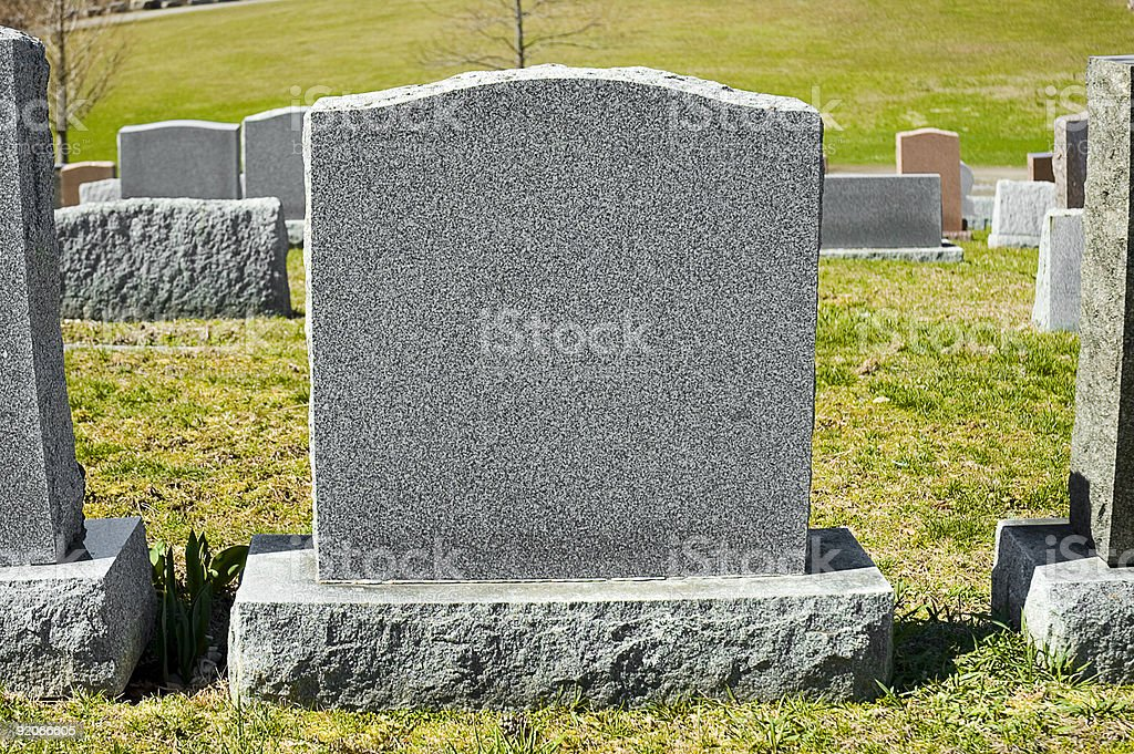 A blank tombstone in a cemetery royalty-free stock photo