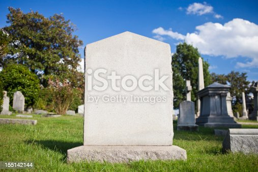 A Blank Tombstone On A Sunny Day