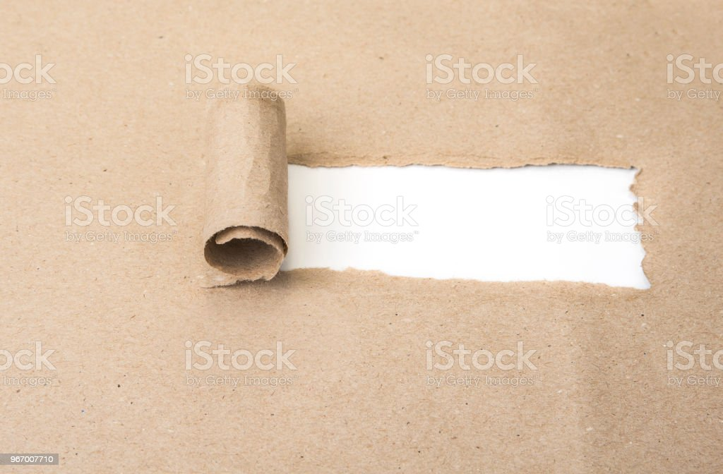 Blank torn brown paper revealing new challenges stock photo