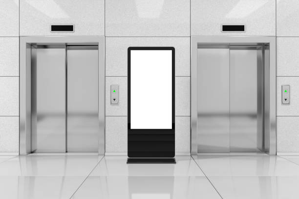 Blank Trade Show LCD Screen Stand as Template for Your Design near Modern Elevator or Lift with Metal Doors in Office Building. 3d Rendering Blank Trade Show LCD Screen Stand as Template for Your Design near Modern Elevator or Lift with Metal Doors in Office Building extreme closeup. 3d Rendering liquid crystal display stock pictures, royalty-free photos & images