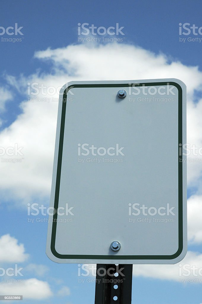 Blank Traffic Sign against a Blue Sky and Clouds stock photo