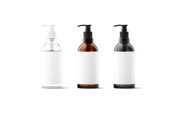 Blank transparent, amber, black glass bottle with white label mockup Blank transparent, amber, black glass pump bottle with white label mockup, 3d rendering. Empty cleanser fluind in dispenser jar mock up, front view. Clear glas tube with sticker for logotype template. bottle stock pictures, royalty-free photos & images